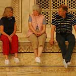 Three package tourists enjoying a break before they're rushed back into their air-conditioned bus ... they had a total of 45 minutes to view the Taj!